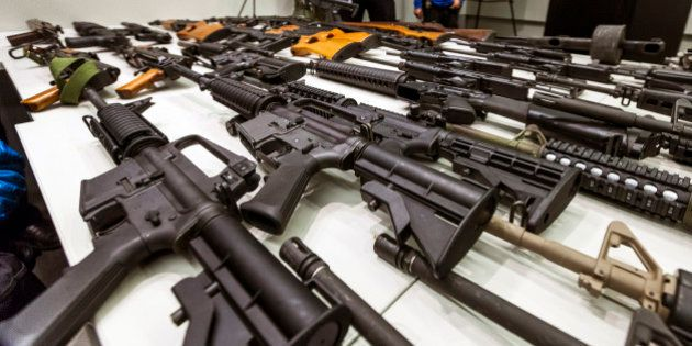 FILE - In this Dec. 27, 2012, file photo, a variety of military-style semi-automatic rifles obtained...