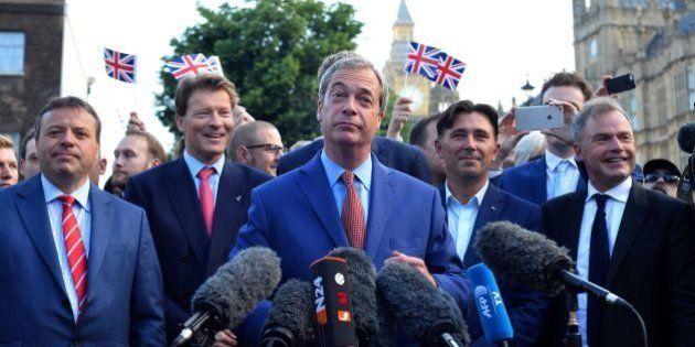 Leader of the United Kingdom Independence Party (UKIP), Nigel Farage (C) speaks during a press conference...