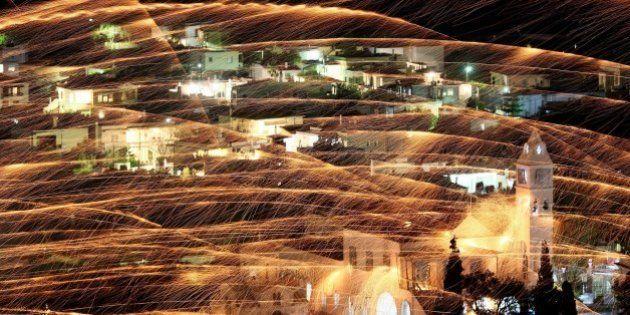 CHIOS, GREECE - APRIL 19: St. Mark's and Panagia Erithiani church congregations perform 'Rocket War'...
