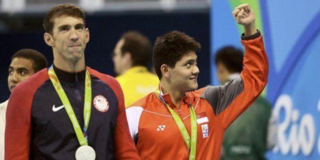 Schooling gana la medalla de oro en 100 metros mariposa frente a