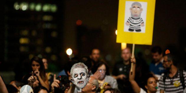 People demonstrate against former Brazilian president Luiz Inacio Lula da Silva at Paulista Avenue in...