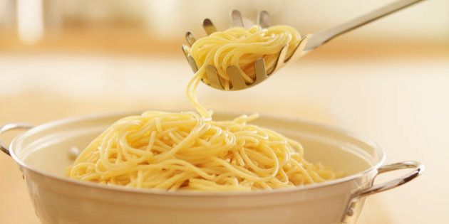 Close up of spoon scooping spaghetti in