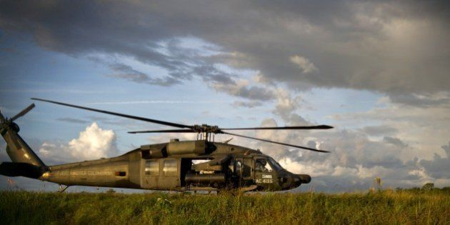 An artillery helicopter of the Colombian Air Force refuels at Carano airport in Quibdo, Department of...