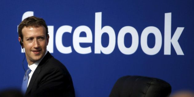 Facebook CEO Mark Zuckerberg is seen on stage during a town hall at Facebook's headquarters in Menlo...