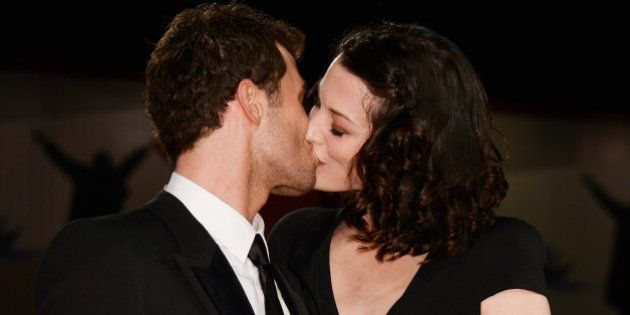 VENICE, ITALY - AUGUST 30: Actor James Deen kisses his girlfriend Stoya at 'The Canyons' Premiere during...