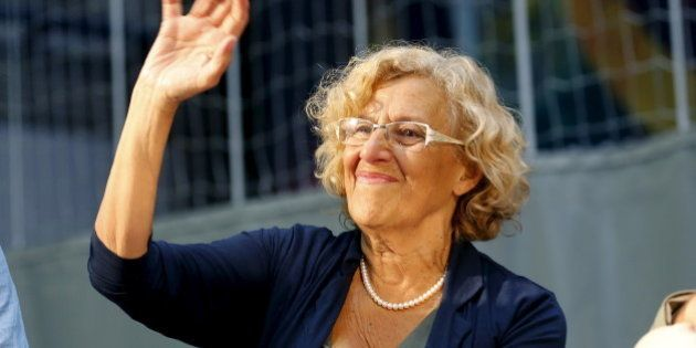 Madrid's mayor Manuela Carmena waves to the crowd in central Barcelona, Spain September 4, 2015. REUTERS/Gustau
