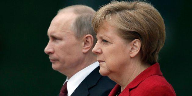 Putin y Merkel piden