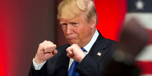 In this Jan. 28, 2016, photo, Republican presidential candidate Donald Trump poses with a ring given...