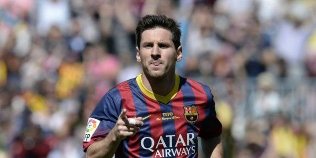 Barcelona's Argentinian forward Lionel Messi celebrates after scoring during the Spanish league football...