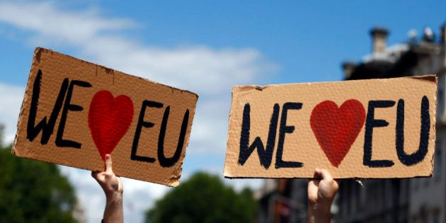 People hold banners during a 'March for Europe' demonstration against Britain's decision to leave the...