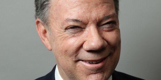 Colombian President Juan Manuel Santos poses for a portrait as he exits a Reuters Newsmaker conversation...