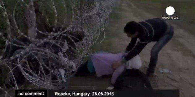 Euronews graba el paso de los refugiados sirios por la alambrada de Hungría