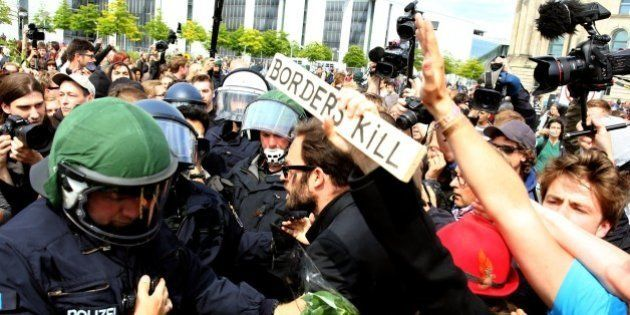BERLIN, GERMANY - JUNE 21: Protesters gather with German riot police in front of the German Parliament...