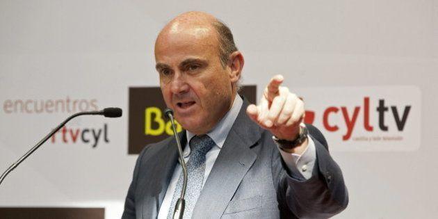 Guindos anuncia rebajas del IRPF y del Impuesto de Sociedades para