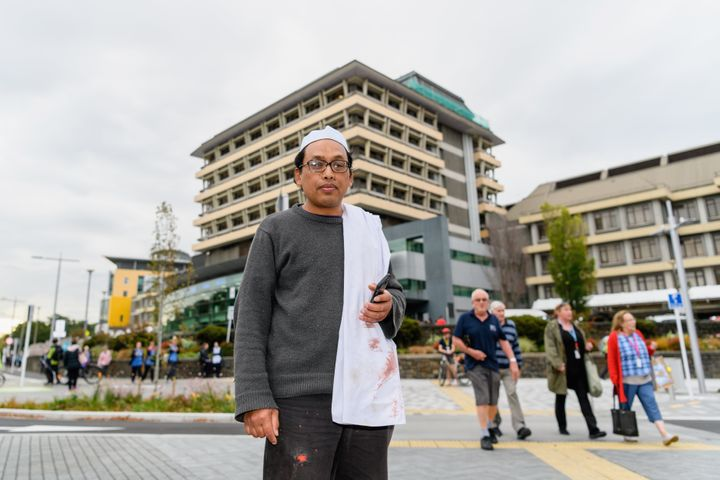 Hamzah Noor Yahaya, a survivor of the shootings at Al Noor mosque, stands in front of Christchurch Hospital at the end of a lockdown on March 15, 2019 in Christchurch, New Zealand.