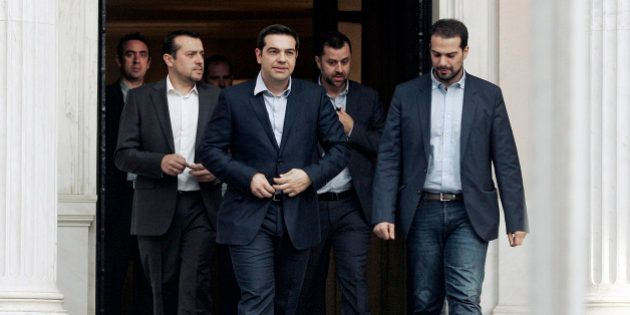 ATHENS, GREECE - JANUARY 27: Greece's Prime Minister Alexis Tsipras (2L) is accompanied by associates...