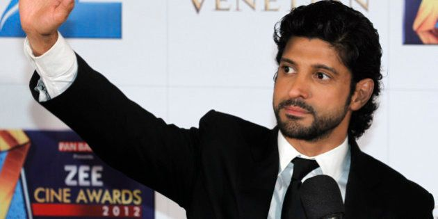 India's director-actor Farhan Akhtar waves on the red carpet of the Zee Cine Awards 2012 in Macau Saturday,...