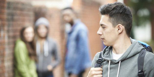 Teenage Boy Feeling Intimidated As He Walks