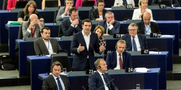 Greek Prime Minister Alexis Tsipras, standing at center, delivers hi speech at the European Parliament...