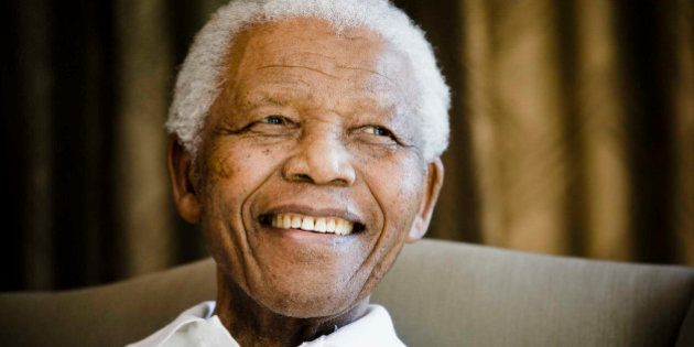 FILE - In this Tuesday, June 2, 2009 file photo, former South African President Nelson Mandela smiles...
