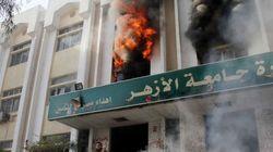 Seguidores de Morsi incendian universidades en Egipto (FOTOS,