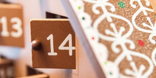 A vertical image shows a close up of a take on an Advent countdown calendar. The countdown is in the...