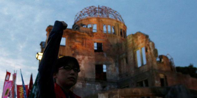 Japanese demonstrators protest against U.S. President Barack Obama and Japanese Prime Minister Shinzo...