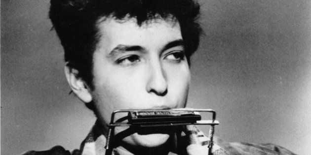 **FILE** Folk singer and songwriter Bob Dylan plays the harmonica and acoustic guitar in March 1963 at...