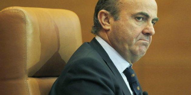 Guindos no descarta más ajustes si el BCE compra deuda española, según 'Herald