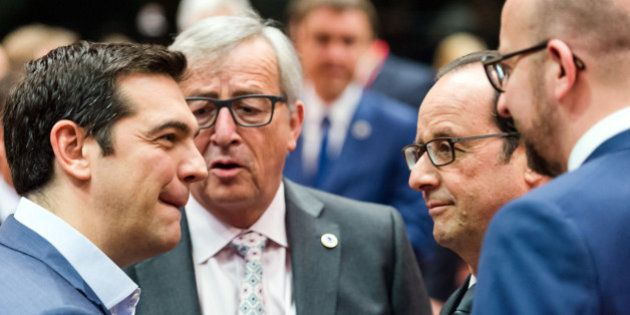 Greek Prime Minister Alexis Tsipras, left, speaks with, from left, European Commission President Jean-Claude...