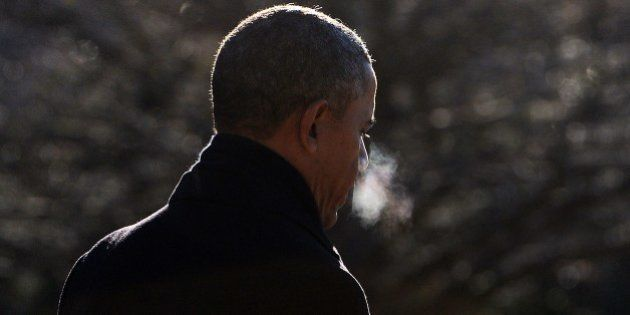 US President Barack Obama walks to board Marine One as he leaves from the White House in Washington,...