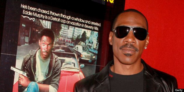 LOS ANGELES, CA - MAY 17: Comedian Eddie Murphy poses before the screening of 'Beverly Hills Cop' during...