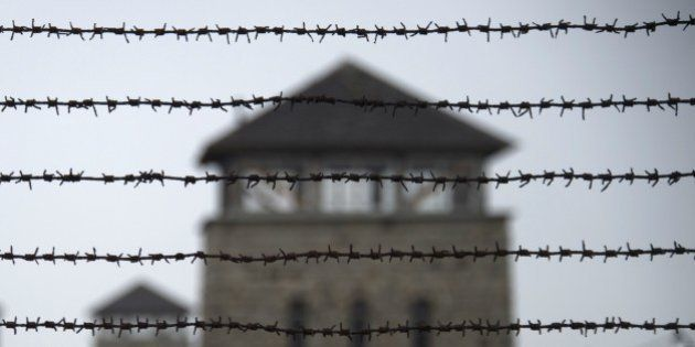 TO GO WITH AFP STORY BY NINA LAMPARSKI A barbed wire fence is pictured at the former Nazi concentration...