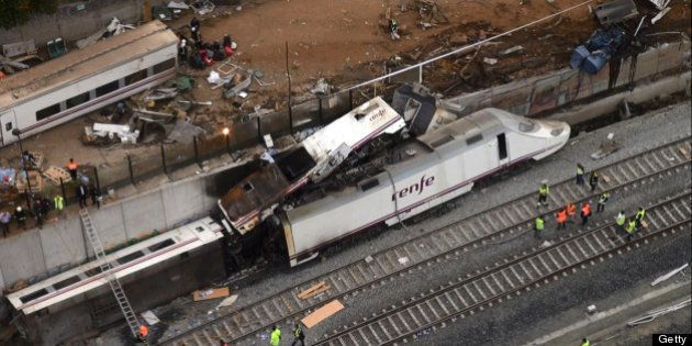 An aerial view shows the site of a train accident near the city of Santiago de Compostela on July 25,...
