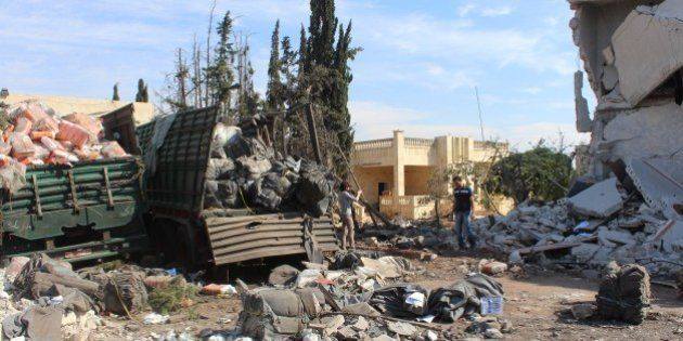 ALEPPO, SYRIA - SEPTEMBER 20 : Wreckage of Syrian Red Crescent aid trucks are seen aid trucks were hit...