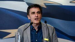 Grecia paga al FMI y reabre sus