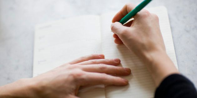 Woman writing on