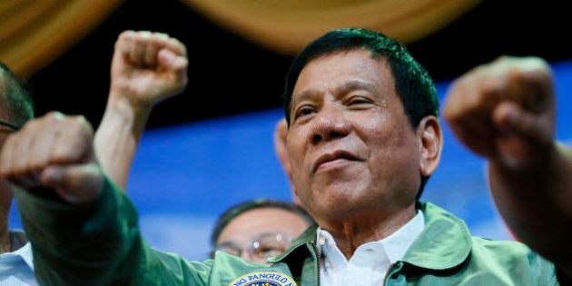 CHANGES AIRLIFT SQUAD NUMBER Philippine President Rodrigo Duterte poses with a fist bump during