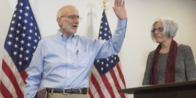 Alan Gross, alongside his wife Judy, leaves a press conference after being released by Cuba on December...