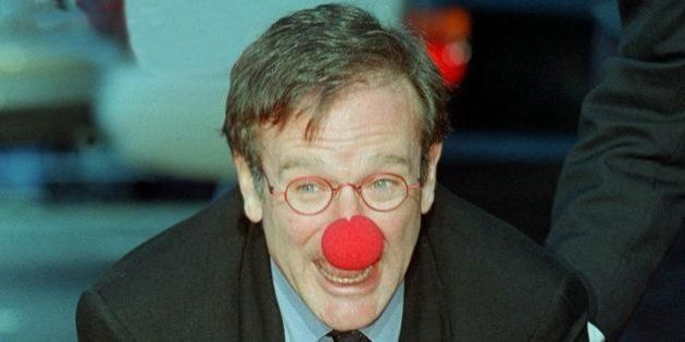 HOLLYWOOD, : Academy Award-winning actor Robin Williams wears a clown nose as he places his hands in...