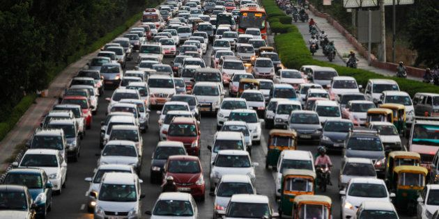 FILE - In this Tuesday, Sept. 23, 2014 file photo, traffic moves at dusk in New Delhi, India. The city...