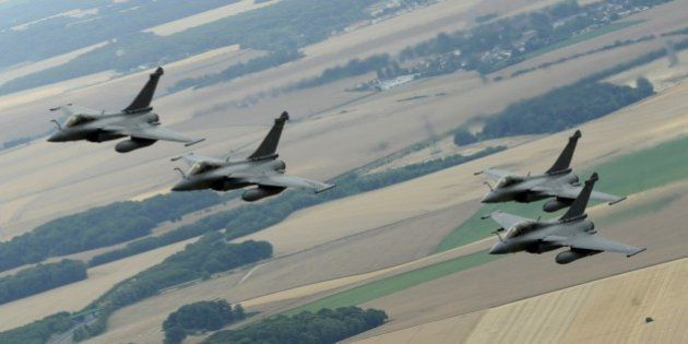 A picture taken on July 14, 2015 from a French Air Force C-135 FR refueling tanker aircraft shows four...