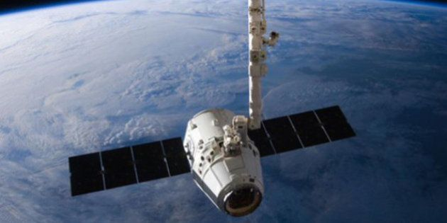 The SpaceX Dragon cargo capsule approaches the International Space Station prior to installation in this...