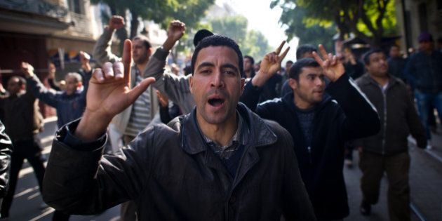 People demonstrate during a protest in central Tunis on January 17, 2011. Tunisian protesters called...