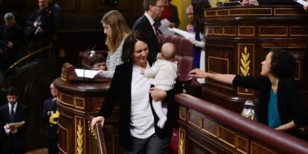 Podemos' deputy Carolina Bescansa holds her baby after depositing her ballot during the constitution...