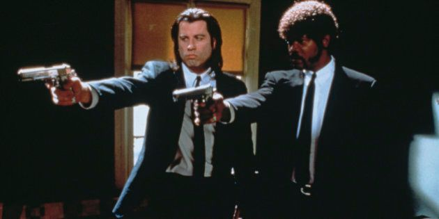 American actors John Travolta (left) as Vincent Vega and Samuel L Jackson as Jules Winnfield in a scene...