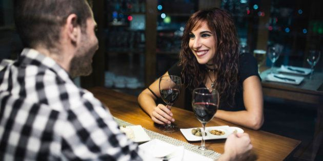 Young couple having a rendezvous in a restaurant at