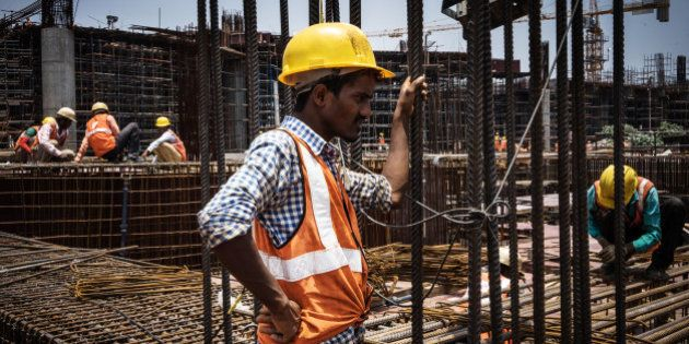 Workers prepare reinforcing steel at the construction site of Majestic metro station, developed by Bangalore...