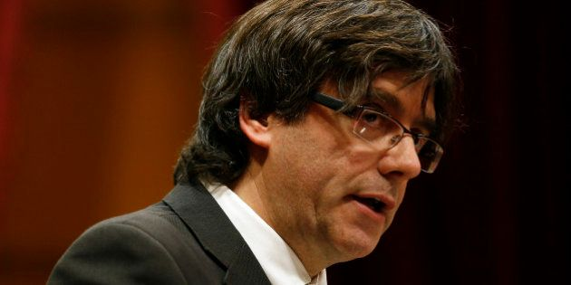Incoming Catalan President Carles Puigdemont speaks during the investiture session at the Catalonian...