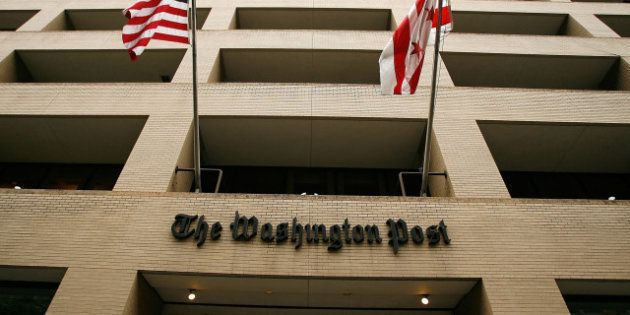 WASHINGTON - MAY 01: Flags wave in front of the Washington Post building on May 1, 2009 in Washington,...